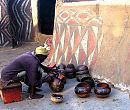 Woman painting pots